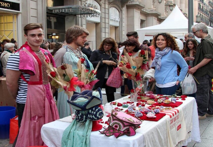 A rose stand (with the vendor dressing the part!) at St. Jordi's Day in Barcelona