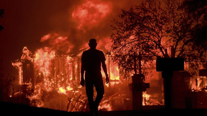 A homeowner in Fountaingrove watches his neighborhood burn in wildfires in California's wine country.