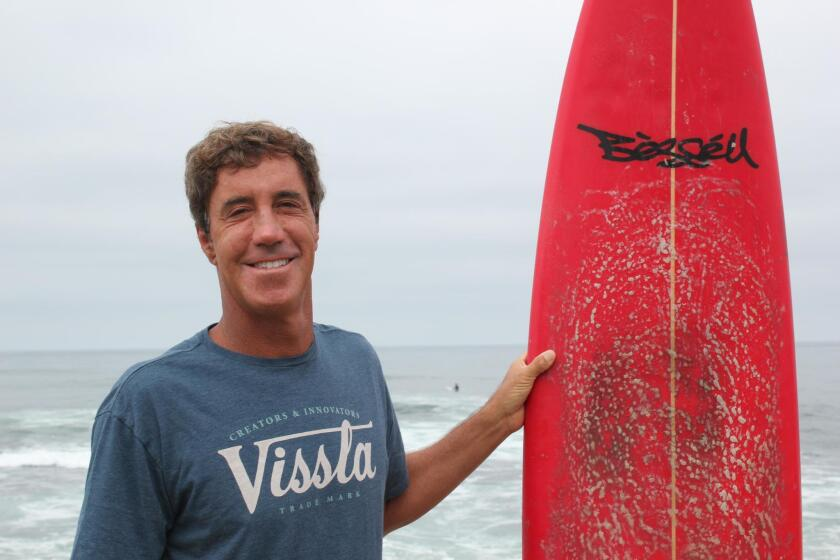 One of Jon Roseman's greatest surf influences, he said, is La Jolla surfboard shaper Tim Bessell. Pictured is Roseman about to catch some waves on one of Bessell's creations.