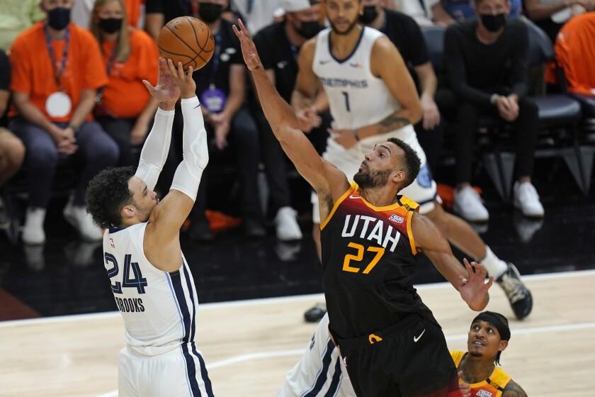 Utah Jazz center Rudy Gobert (27) blocks the shot of Memphis Grizzlies forward Dillon Brooks (24) during the first half of Game 5 of an NBA basketball first-round playoff series Wednesday, June 2, 2021, in Salt Lake City. (AP Photo/Rick Bowmer)