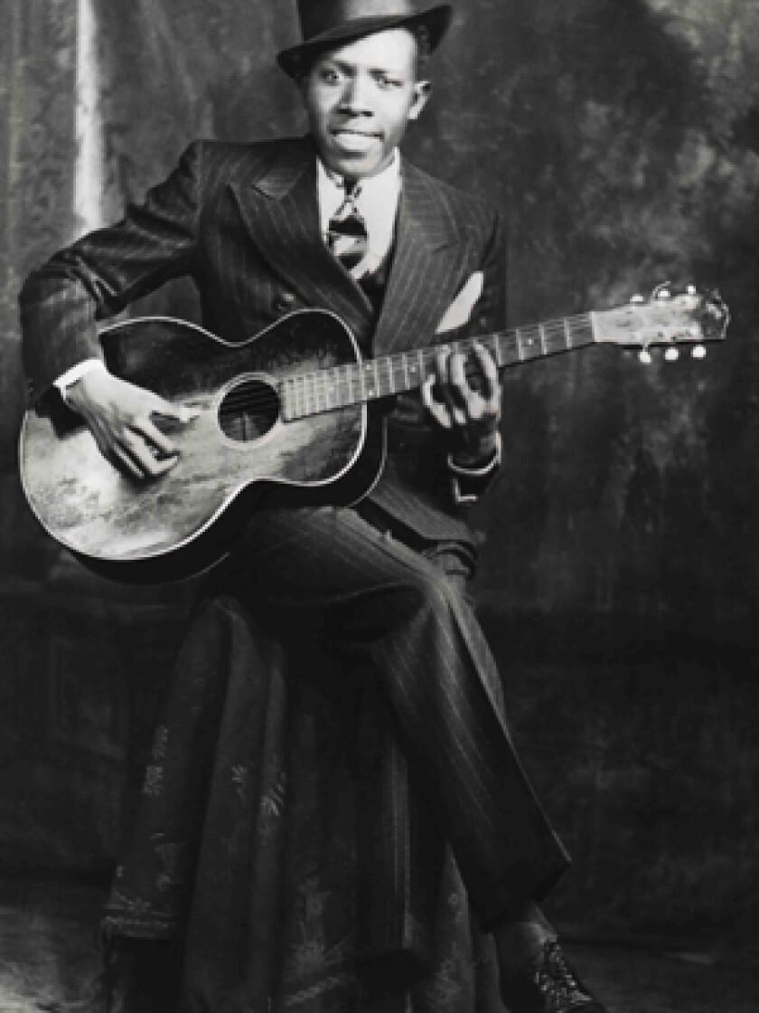 OTHERWORLDLY: Robert Johnson's almost preternatural musical skills helped his legend grow.