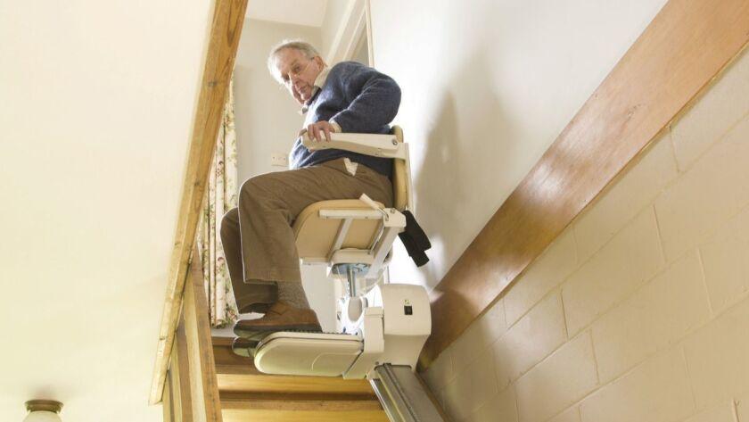 Elderly Man Using A Stair Lift