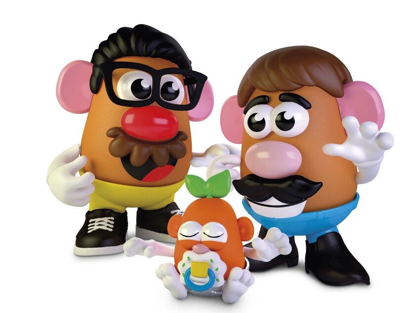 Two adult Potato Head toys with a little Potato Head baby