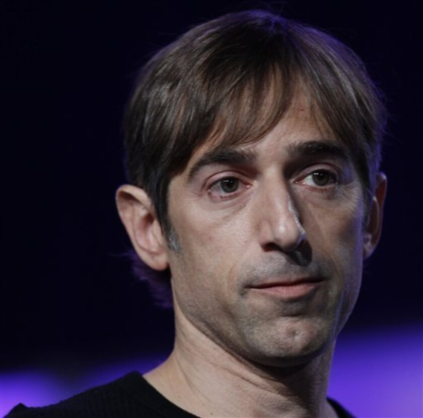 """FILE- In this Monday, Nov. 15, 2010, file photo, Zynga CEO Mark Pincus speaks at the Web 2.0 Summit in San Francisco.  Named after Pincus's late American Bulldog, Zynga, the company that brought us  """"FarmVille,"""" """"CityVille"""" and """"Bubble Safari"""" is now stretching the limits of its Facebook leash.(AP"""