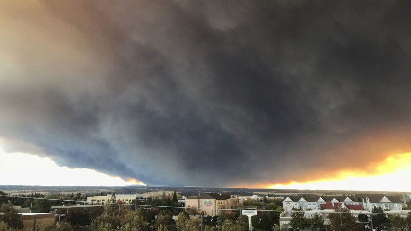 The massive plume from the Camp Fire, burning in the Feather River Canyon near Paradise, Calif., waf