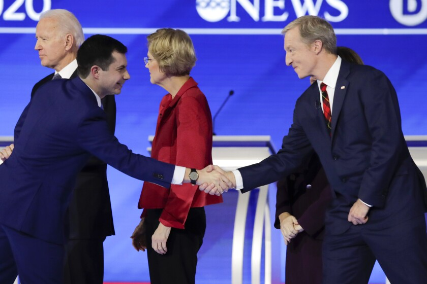 Former South Bend Mayor Pete Buttigieg shakes hands with businessman Tom Steyer onstage before the start of a Democratic presidential primary debate in Manchester, N.H., on Feb. 7, 2020. Also onstage are former Vice President Joe Biden, left, and Sen. Elizabeth Warren (D-Mass.) Only two of these four people are still in the race.