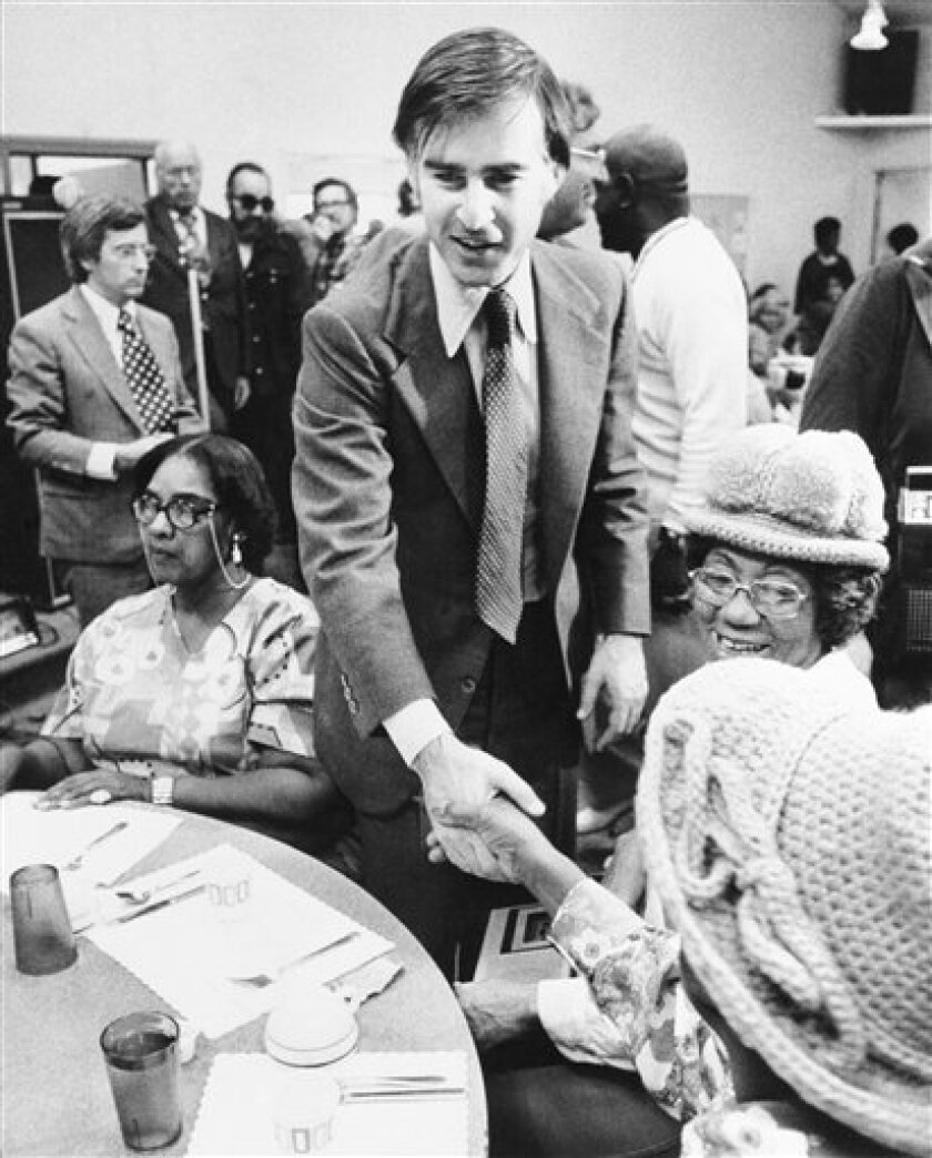 FILE - In this Friday, Oct. 25, 1974 picture, Jerry Brown, Jr., the Democratic candidate for governor, shakes hands during a luncheon sponsored by the Watts Labor Community Action Committee where he spoke. Meg Whitman and Jerry Brown want the same job, but that's where the similarities end for the