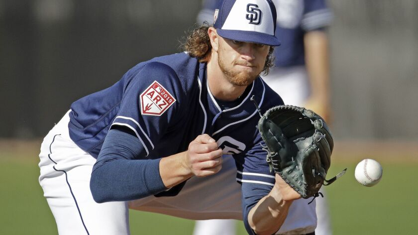 San Diego Padres pitcher Chris Paddack catches a ball during spring training baseball practice Satur