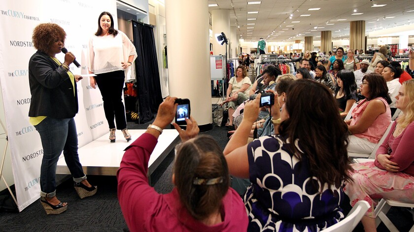 Plus-size fashion blogger Marie Denee, left, hosts a fashion show at Nordstrom in Costa Mesa's South Coast Plaza mall.