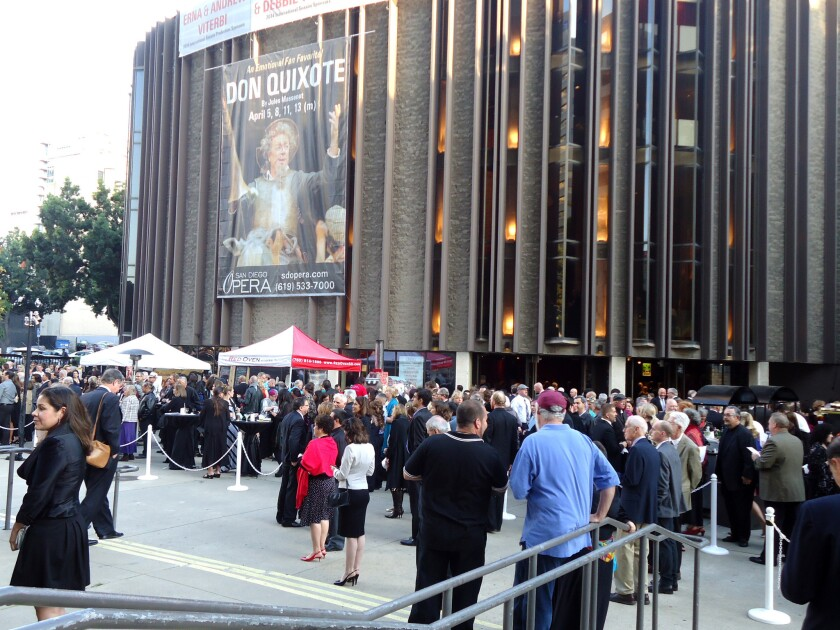"""San Diego Opera patrons gather outside Civic Theatre before a performance of """"Don Quixote"""" earlier this month. Crowdsourced fundraising is part of the recently downsized opera board's strategy for saving the financially troubled company."""