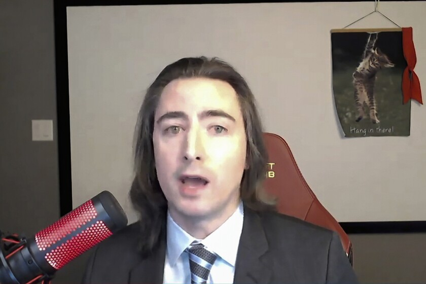 In this image from video provided by the House Financial Services Committee, Keith Gill, also known in social media forums as Roaring Kitty, testifies during a virtual hearing on GameStop in Washington, Thursday, Feb. 18, 2021. Massachusetts is fining MassMutual $4 million and ordering it to overhaul its social-media policies after accusing the company of failing to supervise the employee whose online cheerleading of GameStop's stock helped launch the frenzy that shook Wall Street earlier this year. The settlement announced Thursday, Sept. 16, 2021 centers on the actions of Gill, an employee at a MassMutual subsidiary from April 2019 until January 2021. (House Financial Services Committee via AP)