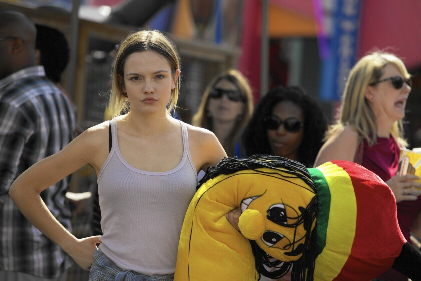 GABBI (Emily Meade) is feeling low after being dumped by her cheating girlfriend in the rom-com.