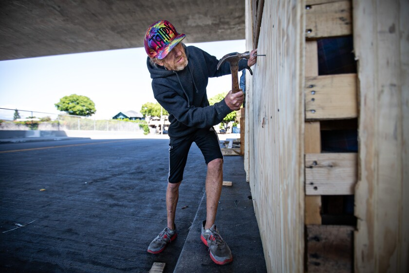 Kenny Welch builds a living structure under a 110 Freeway overpass.
