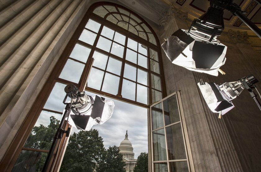 FILE - In this Sept. 9, 2013 file photo television news lights await the start of activity on Capitol Hill in Washington as both houses of Congress return to full legislative session. Lawmakers are streaming back to Capitol Hill after this year's summer vacation for an abbreviated September session in which feuding Democratic and Republican leaders promise action to prevent a government shutdown while holding votes aimed at defining the parties for the fall campaign. Republicans control the House and want to pad their 17-vote majority, so they intend to follow this simple rule: first, do no harm. (AP Photo/J. Scott Applewhite, File)