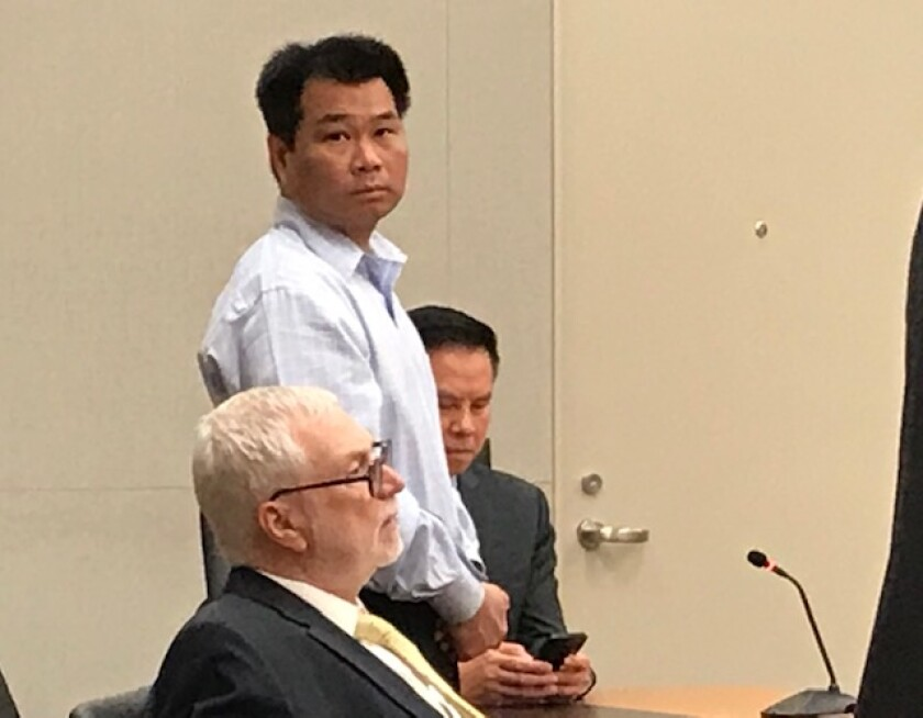 Phong Thanh Huynh stands in San Diego Superior Court near his attorney, William Nimmo, at the end of his trial in May. He was convicted of first-degree murder.