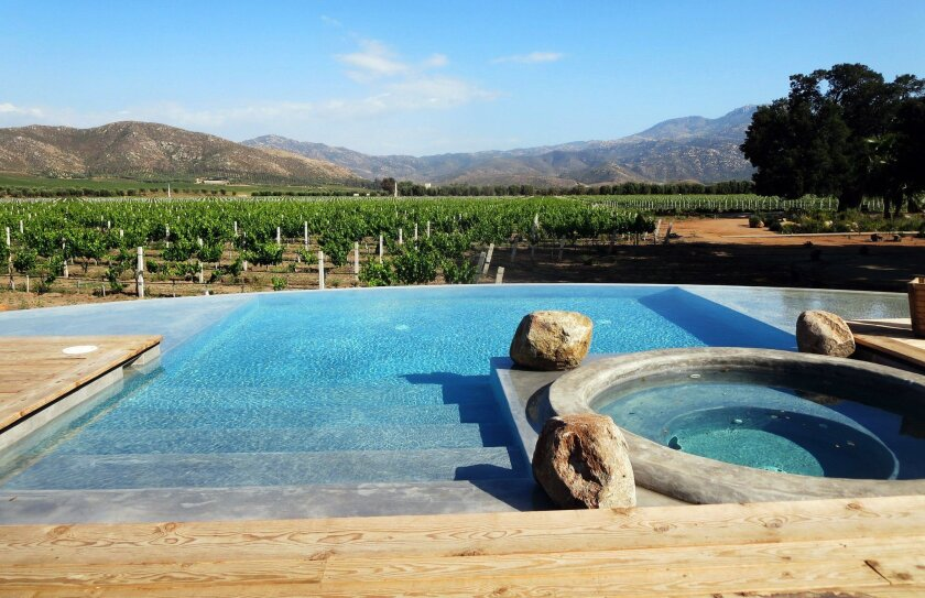 On a lovely summer day, few things can beat lounging by the infinity edge pool and spa overlooking the vineyards at Casa Ocho at Bruma.