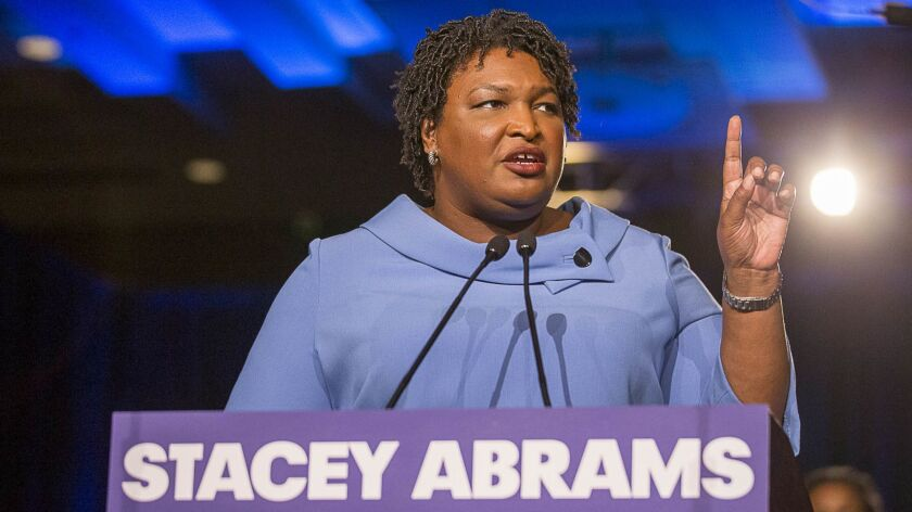 Georgia gubernatorial candidate Stacey Abrams speaks to her supporters during her election night watch party at the Hyatt Regency in Atlanta,