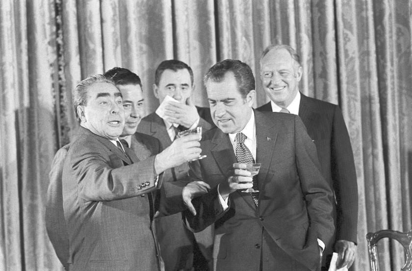 Soviet leader Leonid Brezhnev, left, proposes a toast with interpreter Viktor Sukhodrev, center, and President Richard Nixon.