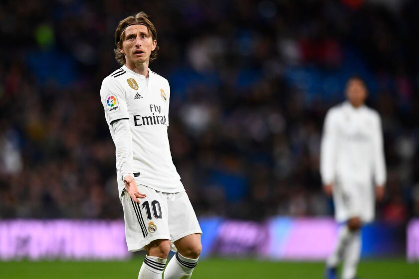 Real Madrid's Croatian midfielder Luka Modric gestures during the Spanish League football match between Real Madrid CF and Real Sociedad at the Santiago Bernabeu stadium in Madrid on January 6, 2019.