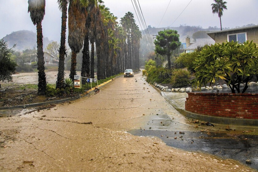 Mud flows down Hicrest Road during heavy rain in Glendora earlier this month. Flood insurance covers mudflow damage, but homeowners and the National Flood Insurance Program sometimes differ on what qualifies as a mudflow.
