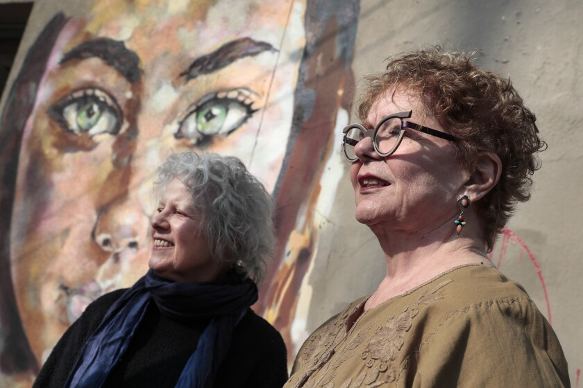 Constance Mallinson, left, and Merion Estes on the streets of the Arts District.