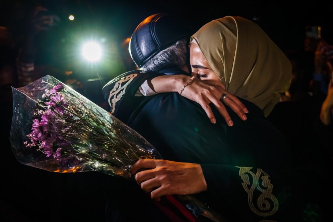 Muna Kurd embraces her father Nabil Kurd