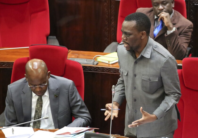 Tanzanian opposition politician Zitto Kabwe, right, speaks at the national assembly in Dodoma, Tanzania Friday, May 5, 2017. With Tanzania facing an October 2020 election that contentious President John Magufuli hopes to win, Zitto Kabwe tells The Associated Press he's trying to unite the opposition behind one candidate for the best shot at an upset. (AP Photo)