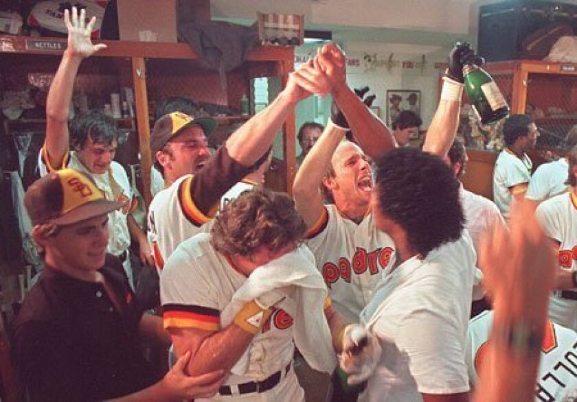 San Diego Padres players celebrate in the locker room at Jack Murphy Stadium on Oct. 7, 1984, after defeating the Chicago Cubs and winning the National League pennant.