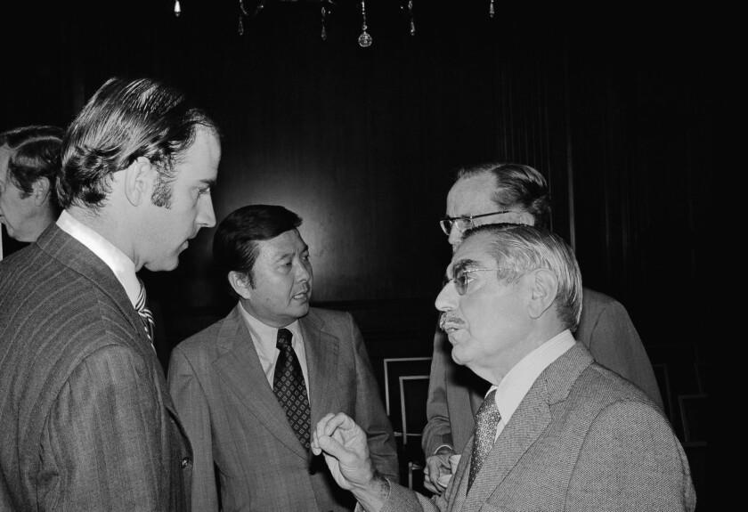 Sen. John O. Pastore of Rhode Island, right, talks with Sen. Joseph R. Biden Jr., of Delaware, left,