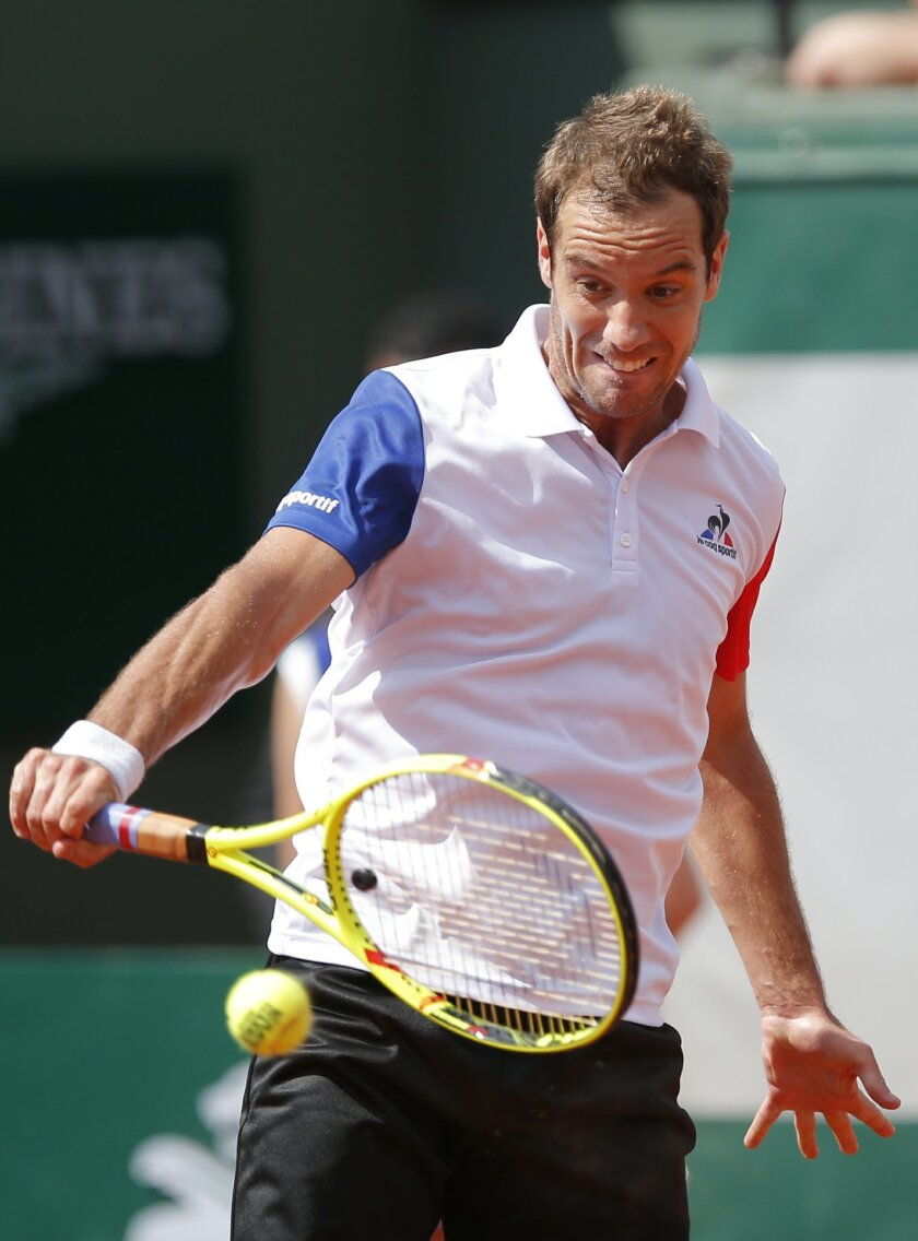 France's Richard Gasquet returns the ball to Bjorn Fratangelo of the U.S. during their second round match of the French Open tennis tournament at the Roland Garros stadium, Wednesday, May 25, 2016 in Paris.  (AP Photo/Christophe Ena)