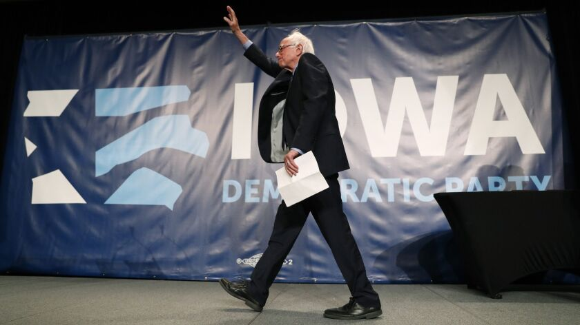 Sen. Bernie Sanders (I-Vt.) walks onstage at the Iowa Democratic Party's Hall of Fame Celebration on Sunday. He joined 18 other presidential candidates wooing voters at the Cedar Rapids event.
