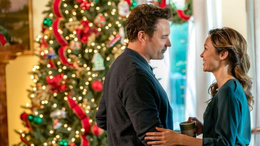 "David Haydn-Jones and Autumn Reeser appear in ""A Bramble House Christmas"" on Hallmark Movies & Myste"