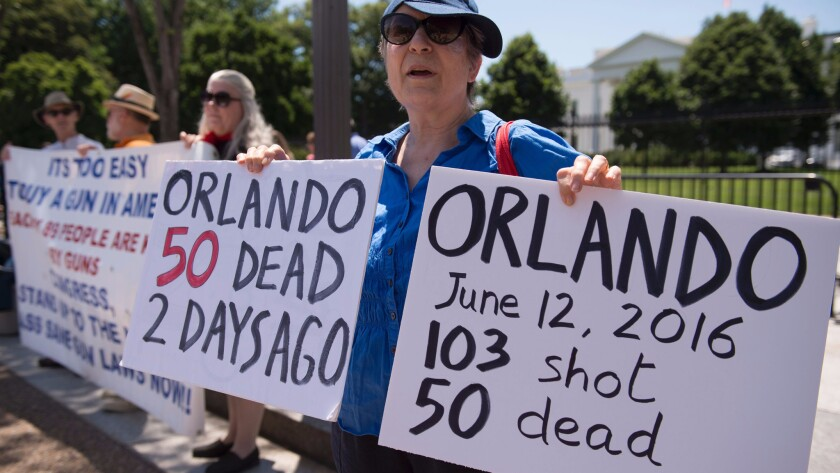 People protest gun violence and call for sensible gun laws outside the White House on June 13.