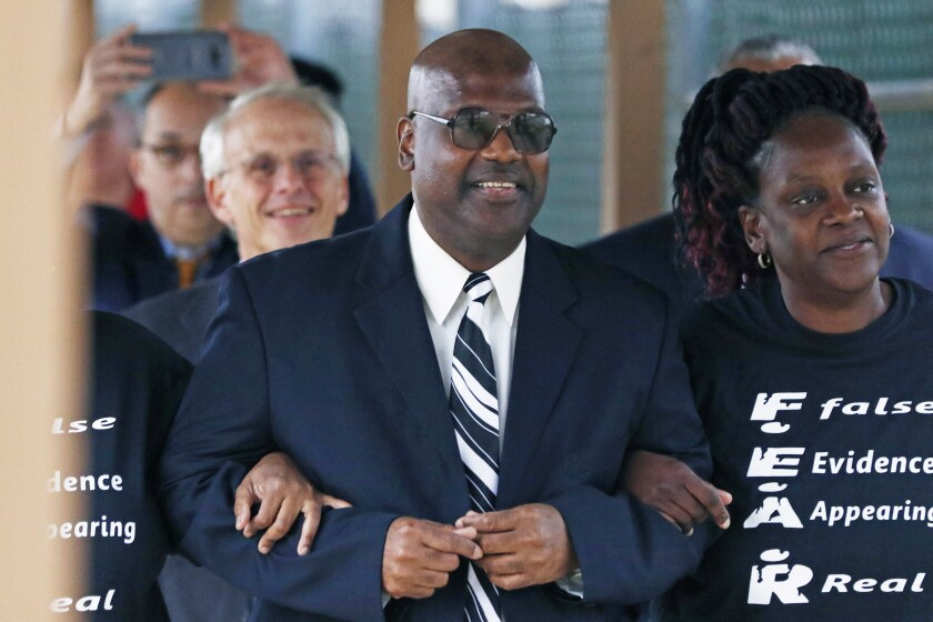 FILE - In this Monday, Dec. 16, 2019, file photo, Curtis Flowers flanked by sister Priscilla Ward, right, exits the Winston Choctaw Regional Correctional Facility in Louisville, Miss. The NFL says it is honoring Flowers, a Black man from Mississippi who was imprisoned more than 22 years. He was freed in late 2019, months after the U.S. Supreme Court threw out the last of his several convictions in a quadruple murder case. (AP Photo/Rogelio V. Solis, File)