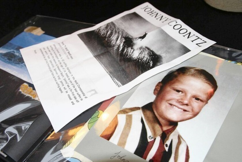 """A photo book made by one of Jonathan """"Johnny"""" Coontz's sisters is on display at the home of Gary Robertson, a childhood friend of Coontz who grew up four doors down."""