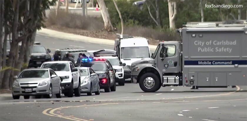 Carlsbad police investigate the scene where a female hiker was found stabbed to death.