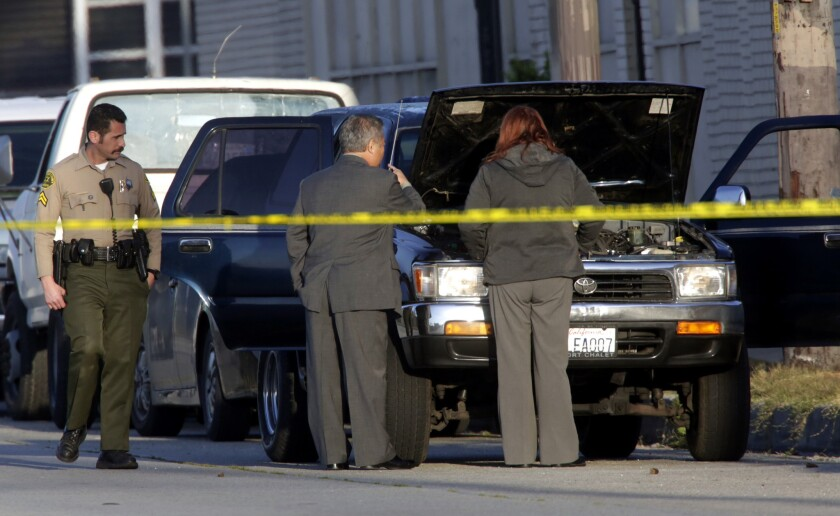 Los Angeles County sheriff's homicide detectives investigate a fatal shooting in the 4800 block of East Telegraph Road in East Los Angeles, where a adult male was found shot to death in a black SUV.