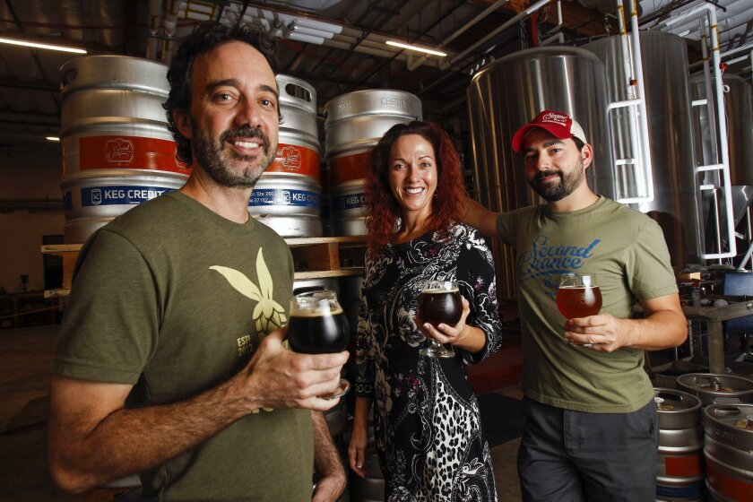 At Second Chance Beer Co. from left, brewmaster Marty Mendiola, legal advisor Virginia Morrison and chief tasting officer Curtis Hawes prepare for San Diego Beer Week.