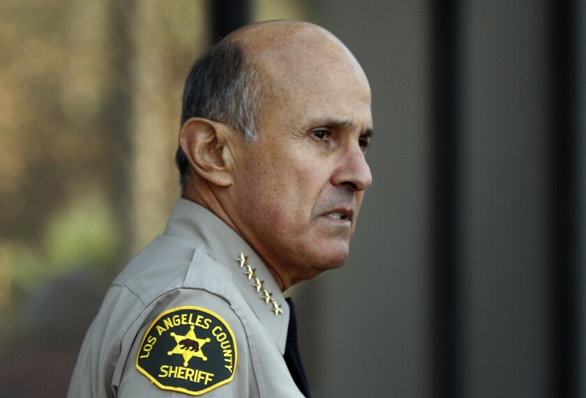 Los Angeles County Sheriff Lee Baca is seen speaking to reporters in Monterey Park. Los Angeles County Sheriff Lee Baca. The sheriff leads a paramilitary agency of uniformed law enforcement officers with the authority to arrest and use deadly force. But unlike his city counterparts -- police chiefs who must report to mayors, city councils or oversight commissions, and sometimes all three -- the sheriff labors under no real oversight at all.