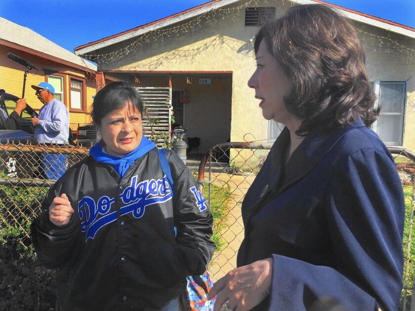 Amelia Vallejo talks to L.A. County Supervisor Hilda Solis about the lead contamination in her yard.
