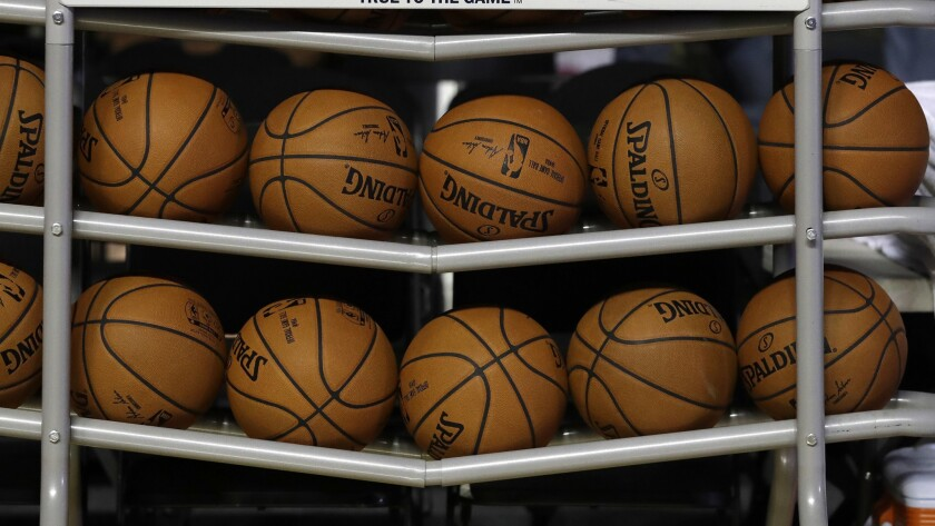 Basketballs sit in a rack on the court during a training session by the Brooklyn Nets at the Mexico
