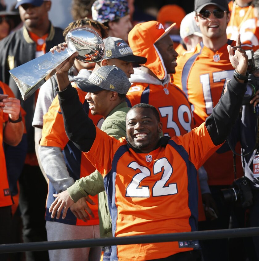 Denver Broncos running back C.J. Anderson holds the Lombardi Trophy at a rally following a parade through downtown Tuesday, Feb. 9, 2016 in Denver. Fans crowded into Denver's downtown to salute the Broncos for the team's victory over the Carolina Panthers in Super Bowl 50. (AP Photo/David Zalubowsk