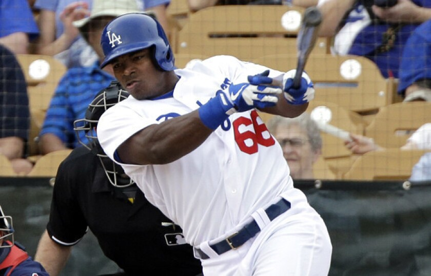 Dodgers outfielder Yasiel Puig hits a three-run home run against the Indians on March 3.