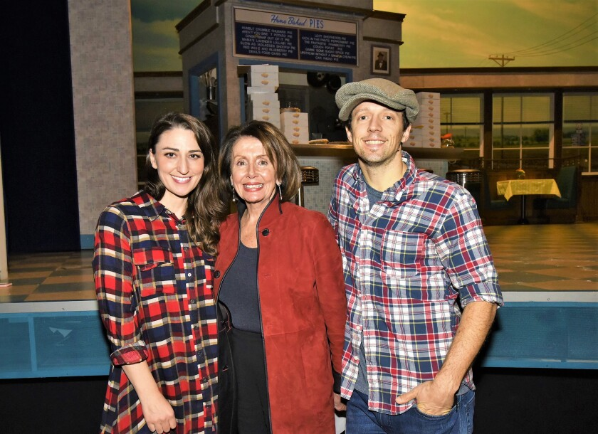 "Sara Bareilles, left, and Jason Mraz, right, posed with U.S. Rep. Nancy Pelosi on the set of ""Waitress,"" in which the singers co-starred, at Brooks Atkinson Theatre on Jan. 27, 2018, in New York City. The photo op took place during a Grammy Awards Congressional briefing which Mraz helped organize."