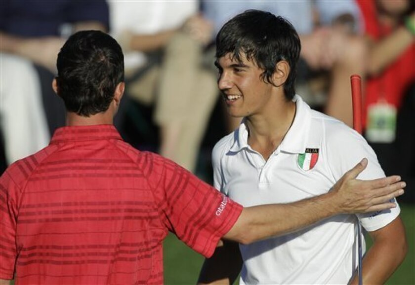 Amateur Matteo Manassero, right, of Italy is congratulated by Mike Weir of Canada on the 18th hole after their second round of the Masters golf tournament in Augusta, Ga., Friday, April 9, 2010. (AP Photo/Chris O'Meara)