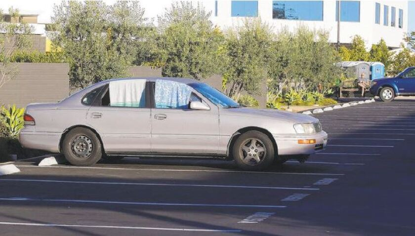 A car parked at the Jewish Family Services complex on Balboa Avenue is one of 40 that stay there each night. Another lot will be opened at Aero Drive and Murphy Canyon Road.