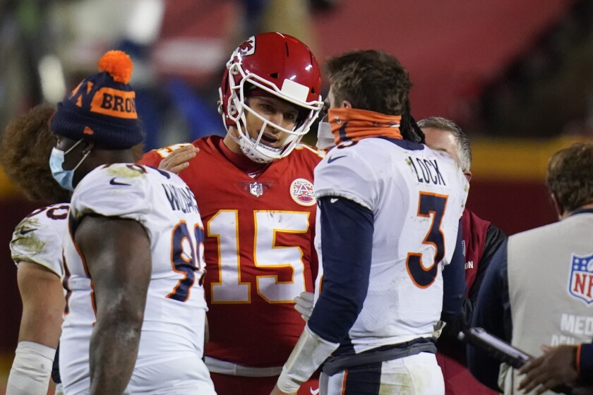 Kansas City Chiefs quarterback Patrick Mahomes (15) talks with Denver Broncos quarterback Drew Lock (3) after an NFL football game in Kansas City, Mo., Sunday, Dec. 6, 2020. Kansas City won 22-16. (AP Photo/Jeff Roberson)