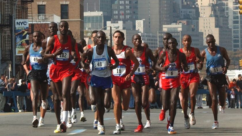 The elite male runners run up 23rd Street in Queens during the 2003 New York City Marathon.