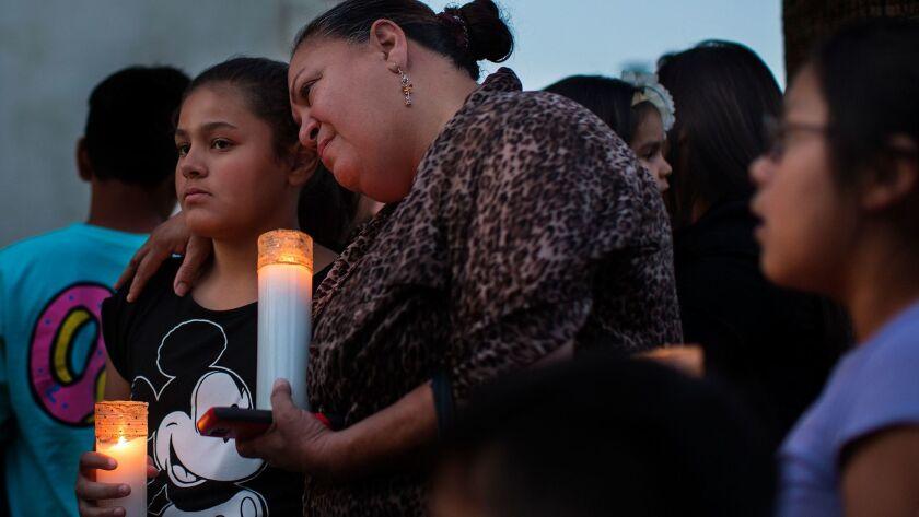 SAN BERNARDINO, CA - APRIL 10, 2017: Betty Rodriguez hugs her granddaughter Giselle Rodriguez, 11,