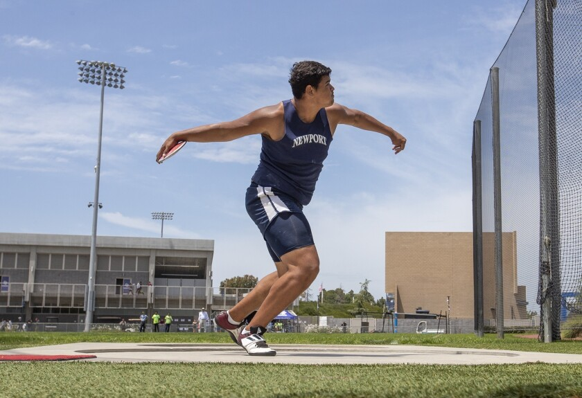 Newport Harbor's Aidan Elbettar throws during the boys' discus at the CIF Southern Section Masters Meet at El Camino College.